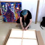 Stretching canvases at Fluorescence Biennale