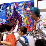 Kids attend to a talk from Pako Campo about his art at Fluorescence Biennale